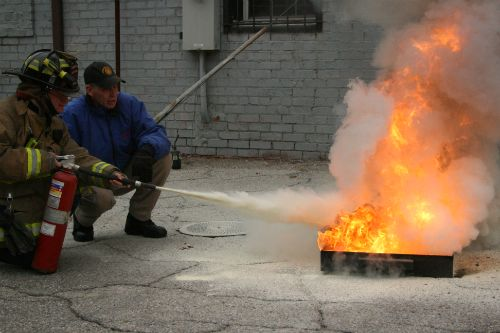 Staff Learn the Proper Use of a Fire Extinguisher with the Indy Fire Department