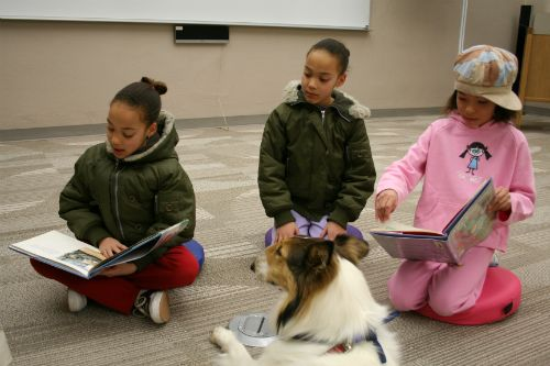 Kids Reading to Therapy Dog
